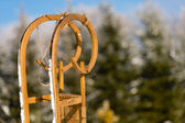 Close-up of wooden sledge standing snow winter — Stock Photo