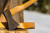 Ax stuck in block of wood winter — Stock Photo