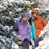 Friends walking through snow winter forest — Stock Photo