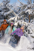 Young people having fun with snow laughing — Stock Photo