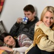 Young friends spend winter holiday cozy cottage — Stock Photo