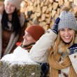 Happy woman with friends winter country cottage — Stock Photo