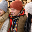 Three friends laughing winter outdoor clothes — Stock Photo