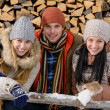 Young people in winter clothes posing outside — Stock Photo #35240643