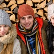 Three friends wearing winter clothes outdoor  — Stock Photo