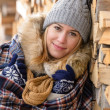 Young woman cover in blanket posing winter — Stockfoto