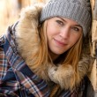 Young woman in winter jacket cover blanket — Stock Photo