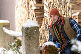 Young handsome man posing winter fashion wood — Stock Photo