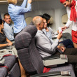 Flight attendant check passenger tickets cabin — Stock Photo