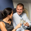 Flight cabin business partners toasting champagne — Stock Photo