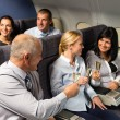 Airplane cabin businesspeople toasting champagne — Stock Photo