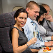 Business travel by plane woman enjoy refreshment — Стоковое фото