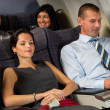 Airplane passenger relax during flight cabin sleep — Stock Photo #35471691