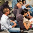Leisure travel people enjoy flight airplane cabin — Stock Photo