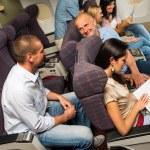 Leisure travel people enjoy flight airplane cabin — Stock Photo