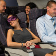 Business woman sleep during flight airplane cabin — Stock Photo