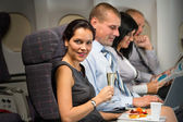 Business travel by plane woman enjoy refreshment — Stock Photo