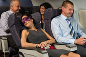 Business woman sleep during flight airplane cabin — Stockfoto