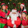 Santa Clause with elf helper woman Christmas — Stock Photo #36823127