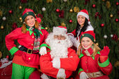 Santa Clause with elf helper woman Christmas — Stock Photo