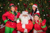 Santa Clause with elf helper woman Christmas — Stock Photo