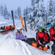 Ski patrol team rescue woman broken leg — Stock Photo #38837267
