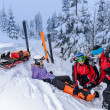Stock Photo: Ski patrol team rescue wombroken leg