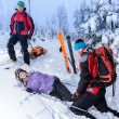 Rescue ski patrol help injured woman skier — Stock Photo #38837269
