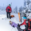Stock Photo: Ski patrol helping womwith broken leg