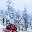 Ski patrol with rescue sled injured woman — Stock Photo #38837303