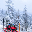 Stock Photo: Ski patrol with rescue sled injured woman