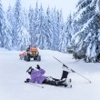 Stock Photo: Ski patrol rescue injured skier after accident