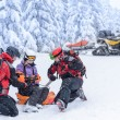 Stock Photo: Ski patrol team rescue wombroken arm