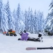 Stock Photo: Injured skier after accident waiting for rescue