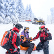 Ski patrol team rescue woman broken arm — Stock Photo #38837503