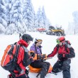 Stock Photo: Ski patrol team rescue woman broken arm
