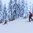 Stock Photo: Rescue ski patrol help injured womskier