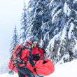 Stock Photo: Ski patrol carry injured person in stretcher