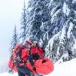 Ski patrol carry injured person in stretcher — Stock Photo