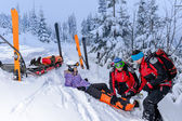 Ski patrol team rescue woman broken leg — Stock Photo