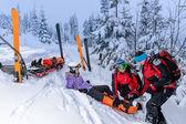 Ski patrol team rescue woman broken leg — Stock Photo