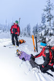 Ski patrol helping woman with broken leg — Stock Photo