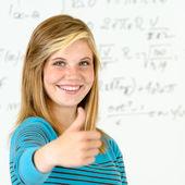 Smiling student girl thumb up mathematics board — Stock Photo