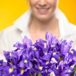 Stock Photo: Purple spring iris flowers woman