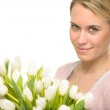 Romantic woman with white tulip bouquet — Stock Photo #40764053