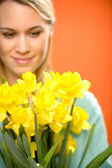 Woman with spring yellow flower narcissus — Stock Photo