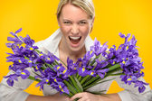 Woman with spring iris flower roar — Stock Photo