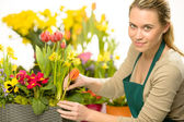Florist arrange spring flowers colorful plants — Stock Photo