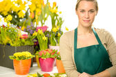 Florist with spring potted flowers — Stock Photo