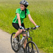 Stock Photo: Wombiking on countryside road sunny day
